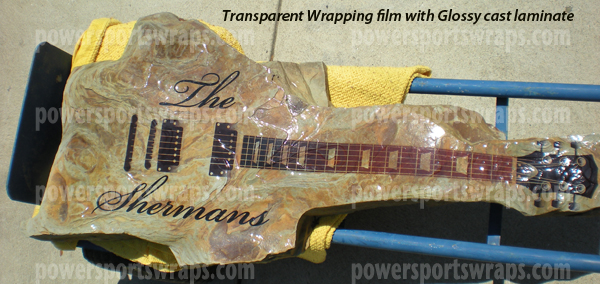 Vinyl decal wrap on a slate rock stone in the shape of a guitar powersportswraps.com