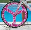 Pink camo bicycle wheel wrapped in powersportswraps.com Pink Camo Micro pattern