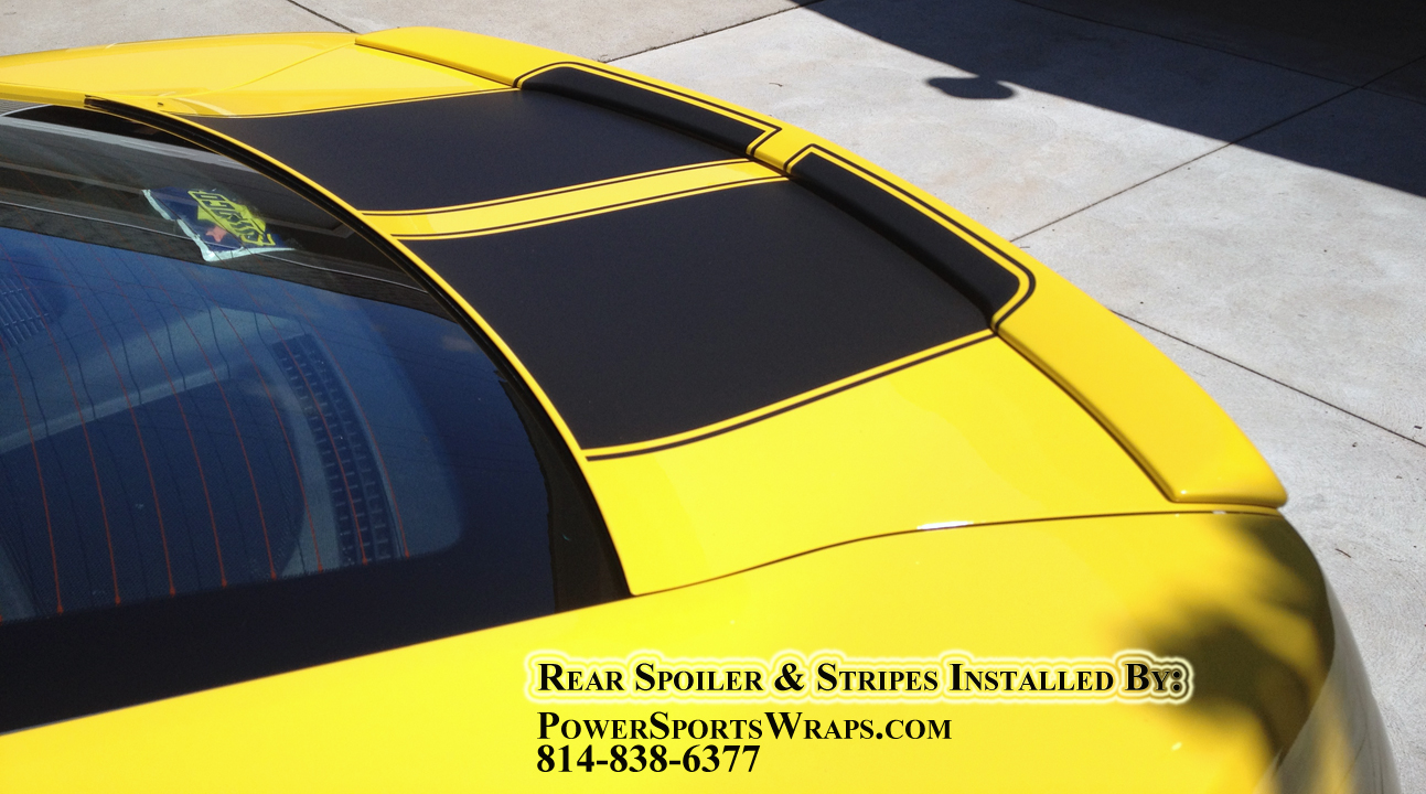matte black racing stripes on yellow camaro